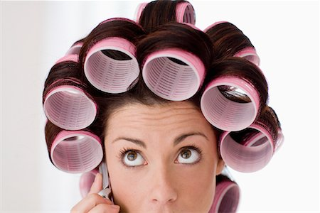Close-up Portrait of Woman Wearing Hair Curlers and using Cell Phone Stock Photo - Rights-Managed, Code: 700-01787598