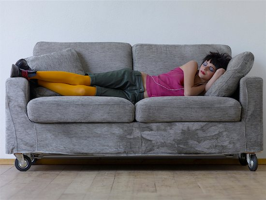 Woman Sleeping on Couch Stock Photo - Premium Rights-Managed, Artist: Siephoto, Image code: 700-01788305