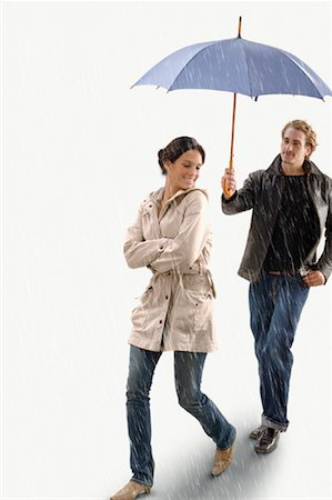 elements (weather) - Man Holding Umbrella Over Woman in the Rain Stock Photo - Rights-Managed, Code: 700-01792437