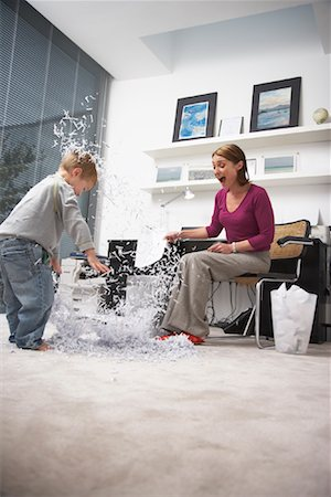 family image and confetti - Woman and Child Making Mess in Home Office Stock Photo - Rights-Managed, Code: 700-01827606