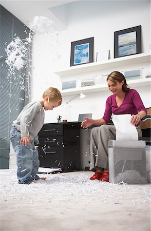 family image and confetti - Woman and Boy Playing with Shredded Paper in Office Stock Photo - Rights-Managed, Code: 700-01827608