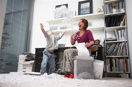 family image and confetti - Woman and Boy Playing with Shredded Paper in Office Stock Photo - Rights-Managed, Code: 700-01827609
