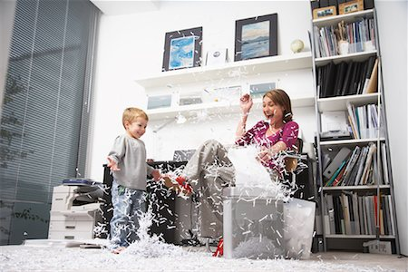 family image and confetti - Woman and Child Playing with Shredded Paper in Office Stock Photo - Rights-Managed, Code: 700-01827610