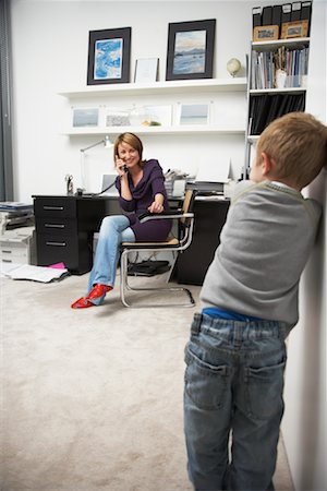 Child Waiting for Woman on Phone in Office Stock Photo - Rights-Managed, Code: 700-01827612
