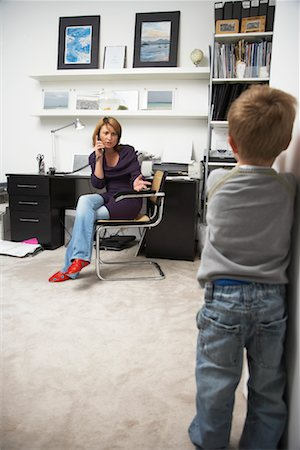 Woman Annoyed at Child Interrupting Phone Call Stock Photo - Rights-Managed, Code: 700-01827613