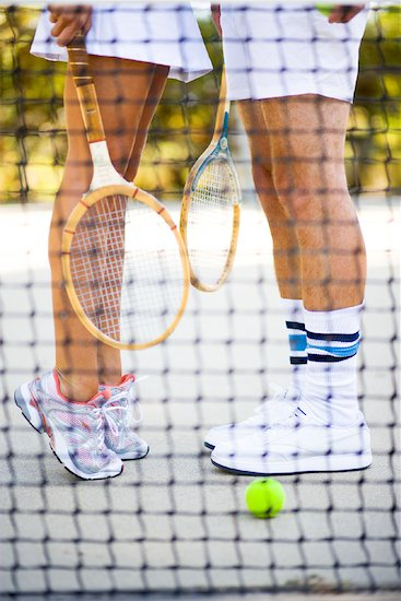 Couple Playing Tennis Stock Photo - Premium Rights-Managed, Artist: Ty Milford, Image code: 700-01837403