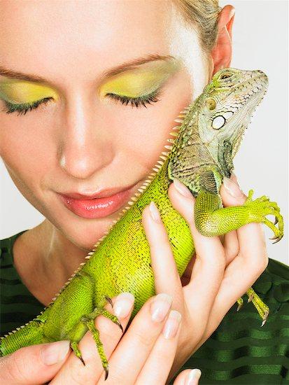 Portrait of Woman With Iguana Stock Photo - Premium Rights-Managed, Artist: Dan Lim, Image code: 700-01837700