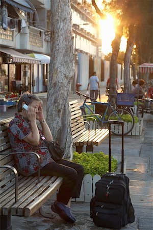 Woman on Bench with Cellular Phone, Cheung Chau, Hong Kong, China Stock Photo - Rights-Managed, Code: 700-01879091