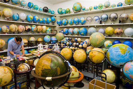 Man Working in Globe Shop, Barcelona, Spain Stock Photo - Rights-Managed, Code: 700-01879661