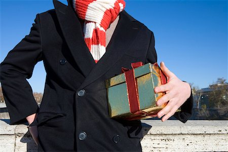 Man Holding Gift Stock Photo - Rights-Managed, Code: 700-01880461