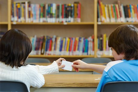 photo of class with misbehaving kids - Students Passing Notes in Library Stock Photo - Rights-Managed, Code: 700-01954559