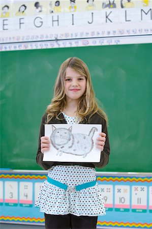 preteen girl pussy - Student in Classroom, Showing Drawing Stock Photo - Rights-Managed, Code: 700-01954550