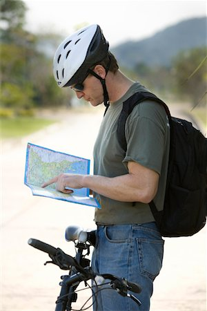 Bicyclist Reading Map, Thailand Stock Photo - Rights-Managed, Code: 700-01954863
