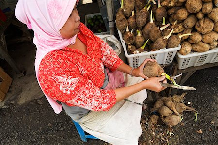 Woman Preparing Taro Root at, Market, Central Java, Java, Indonesia Stock Photo - Rights-Managed, Code: 700-01954936