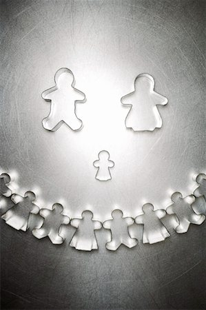 Gingerbread Man and Woman Cookie Cutter Family with Semicircle of Others Stock Photo - Rights-Managed, Code: 700-01955419