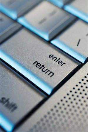 Close-up of Enter Button on Computer Keyboard Stock Photo - Rights-Managed, Code: 700-01955763