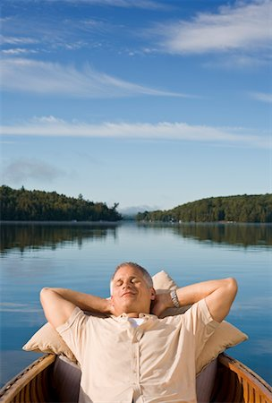 Man Relaxing in Canoe, Haliburton Lake, Ontario, Canada Stock Photo - Rights-Managed, Code: 700-02038151