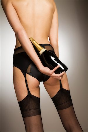 Back View of Woman Wearing Lingerie and Holding a Bottle of Champagne Stock Photo - Rights-Managed, Code: 700-02038210