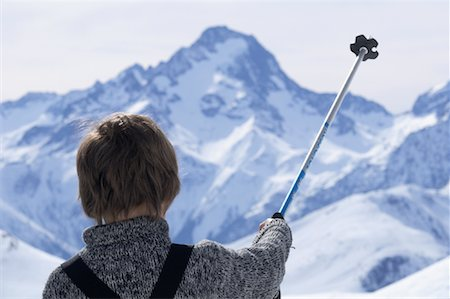 Boy with Ski Pole in Mountains Stock Photo - Rights-Managed, Code: 700-02038265