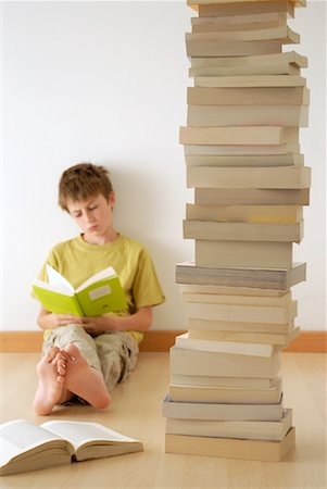 Boy Reading with Pile of Books Stock Photo - Rights-Managed, Code: 700-02038269