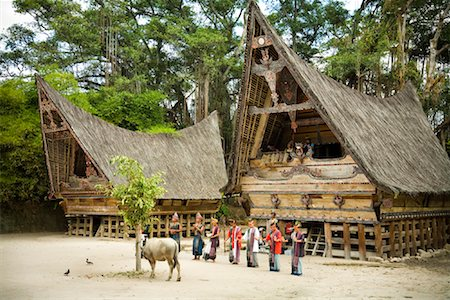 Traditional Dance by Traditional Buildings, Samosir Island, Sumatra, Indonesia Stock Photo - Rights-Managed, Code: 700-02046542