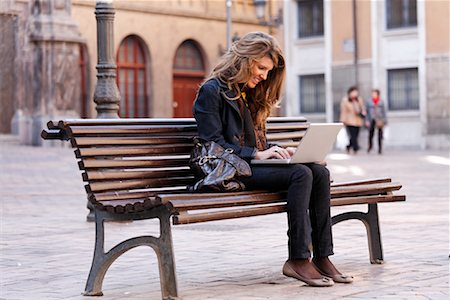 Woman on Bench with Laptop Computer, Zaragoza, Spain Stock Photo - Rights-Managed, Code: 700-02063685