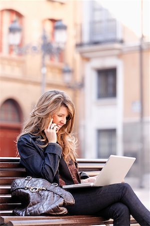 Woman on Bench with Laptop Computer, Zaragoza, Spain Stock Photo - Rights-Managed, Code: 700-02063686