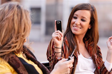 Women with Cellular Phones on Bench, Zaragoza, Spain Stock Photo - Rights-Managed, Code: 700-02063695