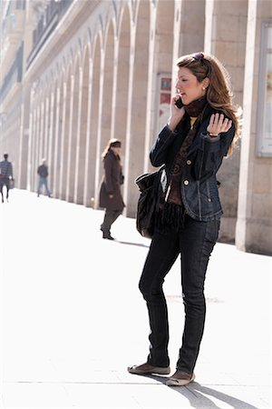 Woman Using Cellular Phone in City, Zaragoza, Spain Stock Photo - Rights-Managed, Code: 700-02063699