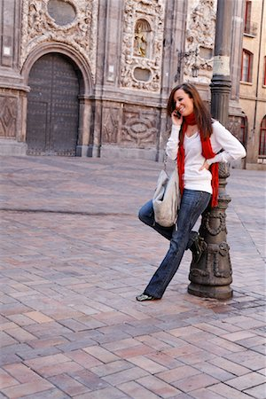Woman in City with Cellular Phone, Zaragoza, Spain Stock Photo - Rights-Managed, Code: 700-02063691