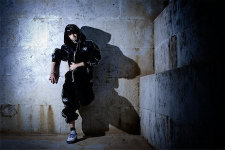 Male Hip Hop Dancer Leaning against Wall Stock Photo - Rights-Managed, Code: 700-02063815