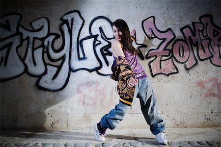 Female Hip Hop Dancer in Front of Wall of Graffiti Stock Photo - Rights-Managed, Code: 700-02063810
