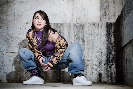 Female Hip Hop Dancer Crouching Down in front of Wall Stock Photo - Rights-Managed, Code: 700-02063811