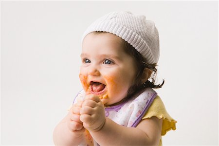 Happy Baby Girl Eating Stock Photo - Rights-Managed, Code: 700-02071301