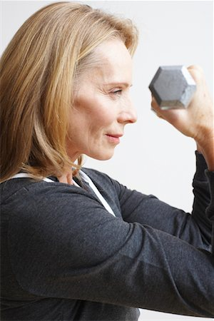 Woman Lifting Weights Stock Photo - Rights-Managed, Code: 700-02071487