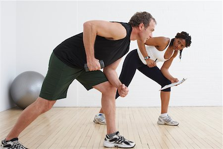Man Exercising with Personal Trainer Stock Photo - Rights-Managed, Code: 700-02071517