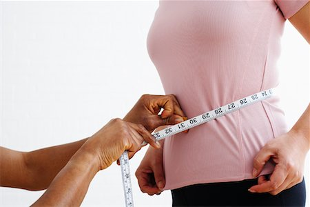 Hands Measuring Woman's Waist Stock Photo - Rights-Managed, Code: 700-02071553