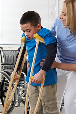 rehabilitation - Female Physiotherapist Helping Boy on Crutches Stock Photo - Rights-Managed, Code: 700-02071744