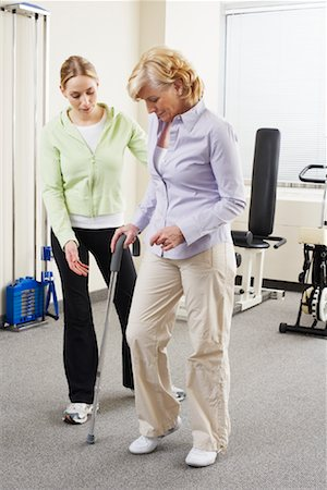 rehabilitation - Woman using Cane with Physiotherapist Checking Progress Stock Photo - Rights-Managed, Code: 700-02071776