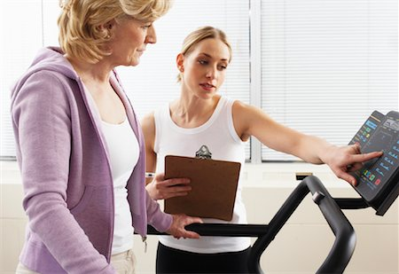 rehabilitation - Woman using Treadmill with Physiotherapist Checking Progress Stock Photo - Rights-Managed, Code: 700-02071771