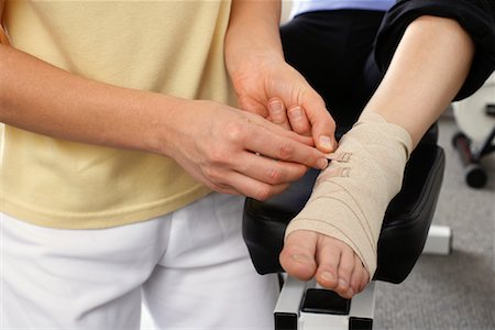 Close-up of Physiotherapist Examining Foot Stock Photo - Rights-Managed, Code: 700-02071817