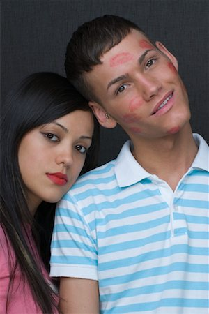 Portrait of Couple, Boy Covered in Kisses Stock Photo - Rights-Managed, Code: 700-02080504