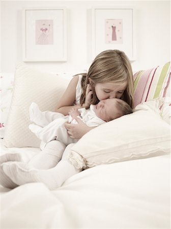 people kissing little boys - Girl Kissing Baby Brother on Bed Stock Photo - Rights-Managed, Code: 700-02080685
