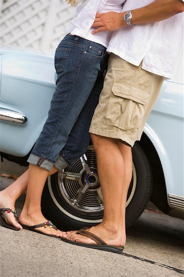Couple Hugging by Ford Mustang, Newport Beach, California, USA Stock Photo - Premium Rights-Managed, Artist: Ty Milford, Image code: 700-02081914