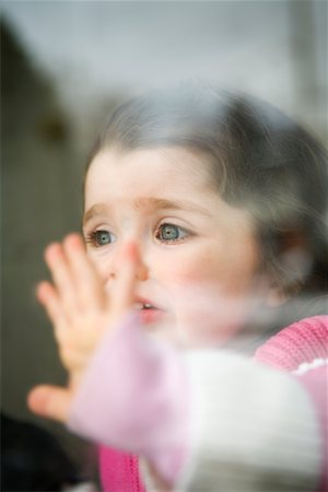 sad girls - Upset Little Girl Looking Out Window Stock Photo - Rights-Managed, Code: 700-02082088
