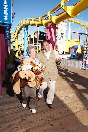 Couple at Amusement Park, Santa Monica Pier, Santa Monica, California, USA Stock Photo - Rights-Managed, Code: 700-02125369