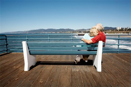 Couple Sitting on Park Bench, Santa Monica Pier, Santa Monica, California, USA Stock Photo - Rights-Managed, Code: 700-02125360