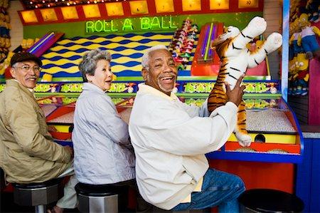 Seniors Playing Amusement Arcade Game at Santa Monica Pier, California, USA Stock Photo - Rights-Managed, Code: 700-02125380