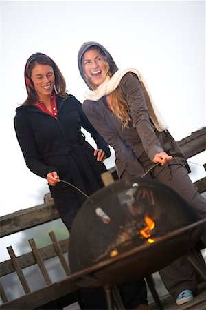 sweater and fireplace - Women Toasting Marshmallows over Fire Stock Photo - Rights-Managed, Code: 700-02125538