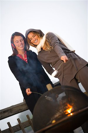 sweater and fireplace - Two Women Roasting Marshmallows Over Fire Stock Photo - Rights-Managed, Code: 700-02125539